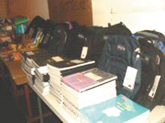 Go Getters distribute supplies to schools