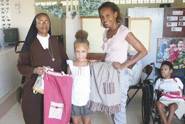 Vincy woman dressing girls around the world