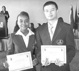 Anesia graduates with double Master's